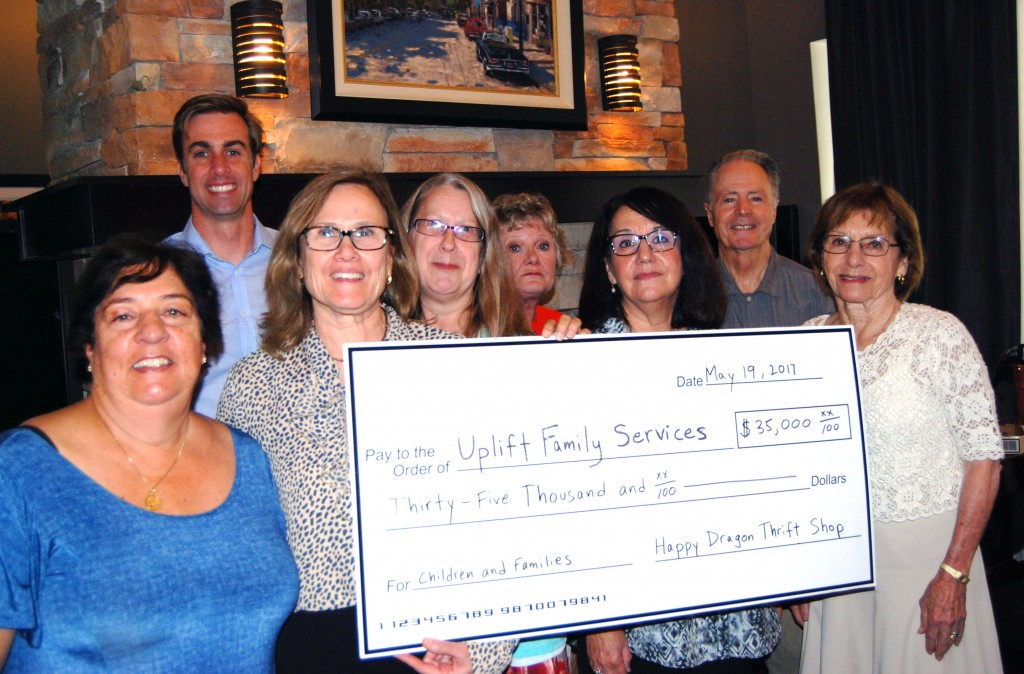 Happy Dragon Presents Donation to Uplift Family Services